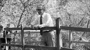 A.A Milne on the Pooh Sticks bridge